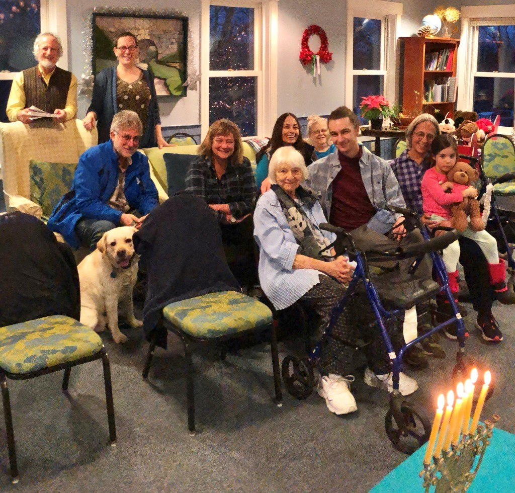 Rabbi Lee, along with Susan Auslander, Deb Schiller, Jennifer Mazur, her granddaughter Athena and   Jim Levinson recently visited Eva Grubinger at the Holton Home to light candles and sing songs on the 5th night of Chanukah. Eva's son Vern, her grandson and their canine companion were also present. A special treat was Jim Levinson playing Chanukah songs on the piano there for the assembled group.