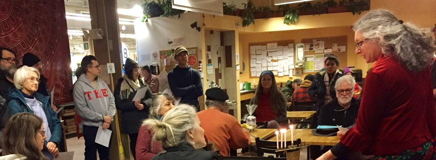 BAJC co-president Laura Berkowitz lights 3rd night candle at Brattleboro Co-op Photo Credit: Stephan Brandstatter