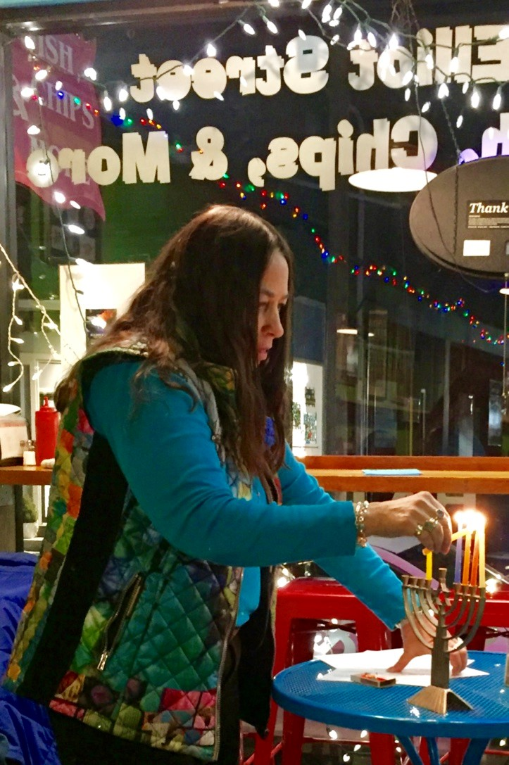 Susan Auslander lights 5th candle, Elliot St. Fish